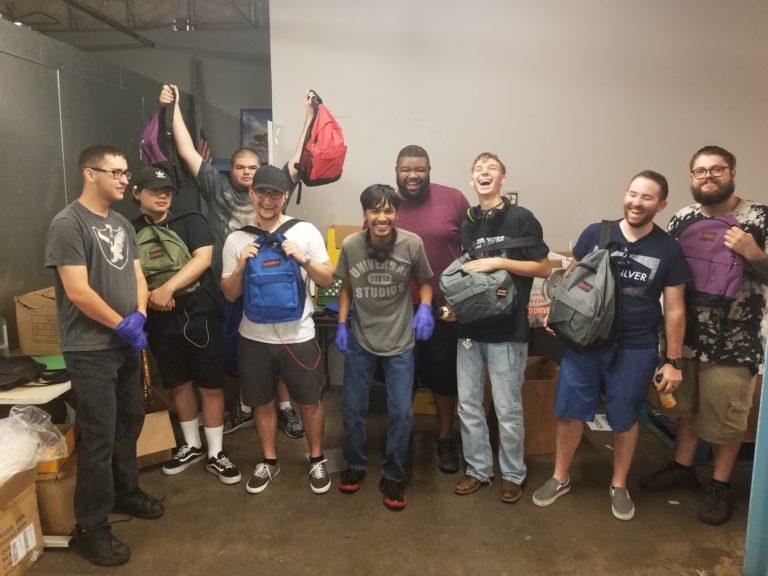 Volunteers with Backpacks